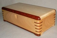 This is my next attempt at making box. The box is built by real solid cherry, padauk and ash wood.