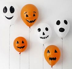 They're selling balloons at the supermarket these days, right? Just pick up a pack of the white and orange variety, grab your nearest Sharpie, and fill in a spooky or playful jack-o-lantern smile in no time at all.