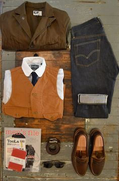 """Engineered Garments Unlined Whipcord Bedford  Gitman Vintage Contrast Club Collar Shirt  Apolis Indigo Dyed Tie  Post O'alls Cruzer Vest  Men's File Issue 7, TooLs 2, and Field Notes """"Red Blooded""""  Oak Street Bootmakers Belt  American Optical Deadstock Safety Glasses  Oak Steet Bootmakers Brown Beefroll Penny Loafer  Levi's Vintage Clothing 1954501z"""