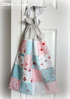 I just love this simple variation of a laundry bag.  Do this in any color scheme.  Great gift for high school graduate going off to college - do fabric to match her room.  Great baby gift - could be used for toys even!   Charm Square Laundry Bag - A Spoonful of Sugar