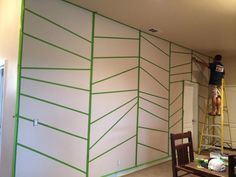 geometric pattern taped on wall with painters tape
