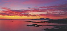 A glorious sunset view of the Small Isles, Scotland