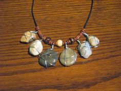 My first attempt at wirewrapping stones. Did these today at the craft fair was at.to show off my daughters stone collection (some of it anyway). Next project is a hanging mobile for the window.
