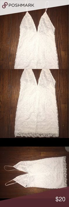 White plunging neckline dress ! This is a great summer selection. According to the tag it's says a large but it fits more like a smeadium. lols Other than that it's very classy. Forever 21 Dresses Mini