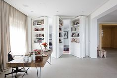 An Art Collector's Apartment in São Paulo, Brazil | pivoting bookshelves - room dividers