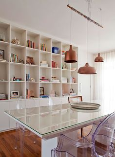 Lucite chairs, natural lighting, and tons of space for books. Perfection.