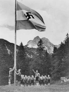 ✠ Hitlerjugend raising the flag.
