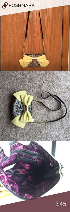 Betsy Johnson Purse Black and white body with a large yellow bow. Great for hanging in shoulder or cross body. The straps are not removable. New WOT Betsey Johnson Bags