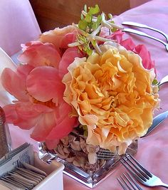 Cube Seashell Centerpiece with Coral Peonies and Peach Garden Roses with a Starfish Accents