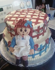 Raggedy Ann - Cake was made to match the invitations for the shower. Mom to be is a military wife and loves the country decor and colonial red, white and blue.