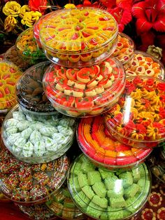 Irresistably colorful cookies @ Geylang Serai Bazaar, Singapore    The Muslim festival of Hari Raya Puasa is only complete with a shopping trip to the glittering Geylang Serai area, which springs into life 1 month before Hari Raya period with roadside   I want to eat all of them