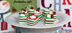 Ingredients: 1 3-ounce box cherry gelatin dessert 1 3-ounce box lime gelatin dessert 3 packets unflavored gelatin 1 14-ounce can sweetened condensed milk 1 1/2 cups vanilla vodka 36 dollops whipped cream (for garnish) 36 mint leaves (for garnish) 72 small red candies (or 36 if using just one for garnish)