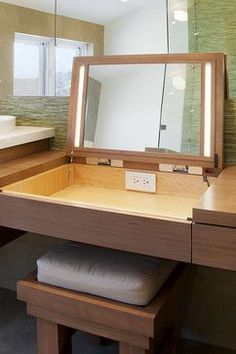 Interesting idea for a pop up make-up mirror with lighting for the ensuite (storae your make-up under the bench). Very cool!