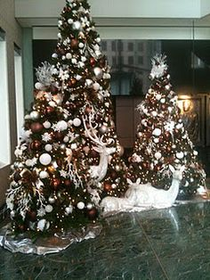 Christmas tree with brown, bronze, white and silver ornaments.  These are the prettiest decorations in downtown Houston.  The pictures don't really show how pretty it is.
