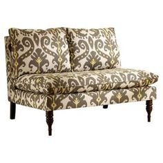 Settee with ikat-print linen upholstery and turned legs. Handmade in the USA.   Product: Settee   Construction Material: Polyurethane, solid pine and polyester foam   Features: Handmade in the USA   Will enhance any dcor Dimensions: 33.5 H x 50 W x 31.5 D
