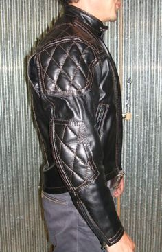 Contrasting brown thread and black hardware zippers etc.
