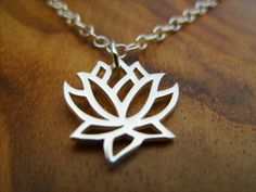 Sterling Silver Small Lotus Flower Blossom Pendant on a Sterling Chain with Secure Clasp Etsy Sale. $26.50, via Etsy.
