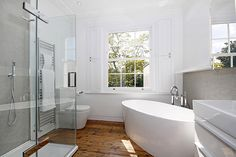 Contemporary bathroom in white with standalone tub - Decoist