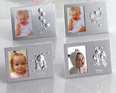 Detalles para bautizo, marco de fotos metal. Se sirven los cuatro modelos. Medida de la foto: 4,5 x 6,5 cm Medida del marco: 11,50 x 8 cm