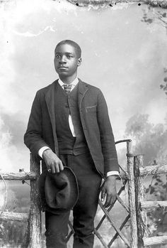 African American man holding hat wearing suit by Black History Album, via Flickr