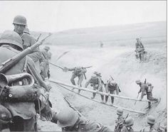 German infantry List crossing an anti tank ditch during the advance through Soviet Russia .Note the company bugler on the left. Hard to imagine, but there were still bugle calls, at least in the opening days of the invasion.