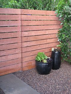 Horizontal fence using modified Home Depot dog ear fence panels.