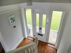 Light grey composite door with glass side panels interior