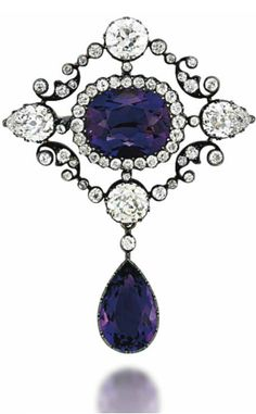 A LATE 19TH CENTURY AMETHYST AND DIAMOND BROOCH The central cushion shaped amethyst and old-cut diamond cluster, within a lozenge shaped openwork diamond-set frame with circular and pear shaped single-stone highlights, suspending a pear shaped amethyst drop, mounted in silver and gold, circa 1890, 5.1cm long, detachable brooch fitting