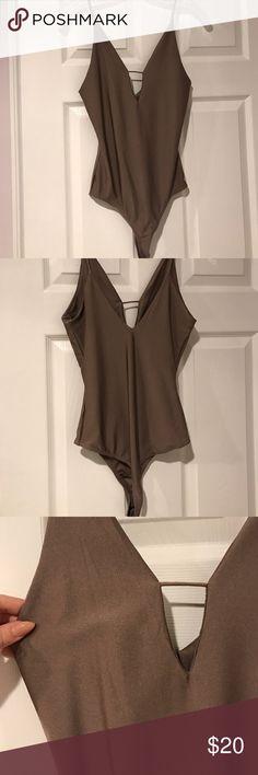 bronze body suit 80% Nylon 20% spandex!! so comfortable and slimming when on, in perfect condition!! ❗️❗️no trades ❗️❗️ LA Hearts Tops