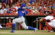 Extra-inning slam:   Chicago Cubs' Javier Baez follows through on a grand slam off Cincinnati Reds relief pitcher J.J. Hoover during the 15th inning on June 28 in Cincinnati. The Cubs won 7-2.