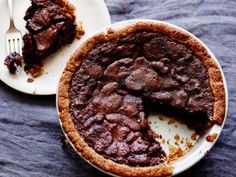 Bourbon and Chocolate Pecan Pie - unbelievable dessert.  Made for Super Bowl party (Feb '15) and it was a hit.  Subbed out 1/4 cup blackstrap molasses and used store-bought crust; recipe makes two WF pie-crust-sized pies (freezes very well).