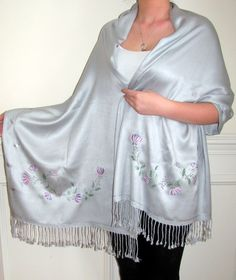 This Unique Border Design Hand Painted Silver Pashmina Shawl is made by an experienced artist in CT for Yours Elegantly. It is beautiful and elegant. Silvery Grey Pashmina silk shawl with Blue, purple, lilac & pink flowers with silver highlights and a green silvery vine design makes this shawl a beautiful must have hand crafted evening shawl wrap.