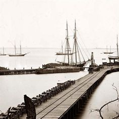 City Point, Virginia Wharf, Federal artillery, and anchored schooners during the American civil war.