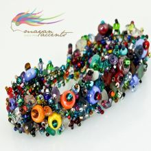 The original design and mix of beads and crystals makes this woven bracelet a must-have accessory. Put on this classic bracelet when you want to shine. Fastens with a handwoven clasp with crystals. Material: Glass beads , pearls and CZ Crystals Labor: 2.6 hours