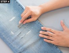 If patience isn& your thing, nor is the idea of mass-manufactured holes, we put together an easy step-by-step guide on how to distress your jeans at home. Diy Distressed Jeans, Diy Ripped Jeans, Holey Jeans, Diy With Jeans, Denim Jeans, Patched Jeans, Diy Holy Jeans, How To Rip Your Jeans, Cut Up Jeans