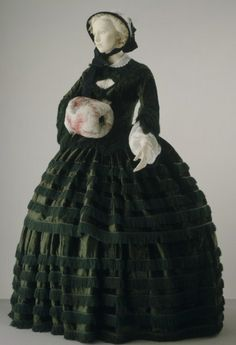 Lovely dress trimmed with fringe, with bonnet and muff.