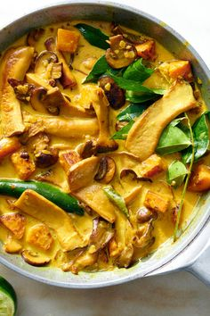 NYT Cooking: This is comfort food, Indian-style, adapted from a recipe by Madhur Jaffrey. It's also vegan, and perfect for a fall evening. Use a mixture of cultivated mushrooms; they come in all shapes and sizes. Look for royal trumpets, a large, meaty type of oyster mushroom; shiitakes, and small portobellos. Use some wild mushrooms too, if you can, like golden chanterelles, lobster or hen of the woods. Yo...