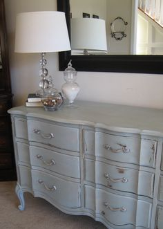 Image from http://amorty.com/wp-content/uploads/2014/02/decorating-ideas-inspiring-furniture-decoration-with-rectangular-greyish-blue-dresser-along-with-glass-table-lamp-and-white-flare-lampshade-gorgeous-greyish-blue-paint-for-wall-and-furniture-decor.jpg.