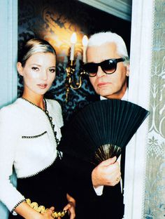 Kate Moss and Karl Lagerfeld photographed by Ellen Von Unwerth for American Vogue, October 1996. Clothing by Chanel.