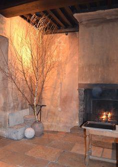 fireplace vervoordt door   Restaurant interiors by Axel Vervoordt