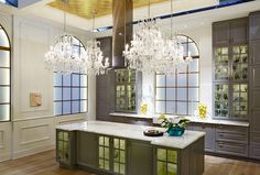 KITCHEN in soft grey -- another key trend colour -- and mixing chandeliers in the room give it a regal feeling.
