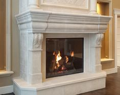 The Normandy is an impressive and elegant fireplace mantel.