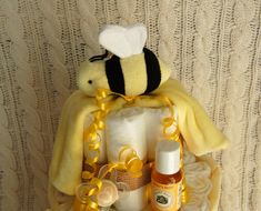 Not sure what to pick off of the baby registry? Why not give a gift that has a little bit of everything?  These diaper cakes are all unique and can be customized to suit your needs! Feel free to contact me with any specific customizations. The more creative the better!  This Bumble Bee Diaper Cake includes: - A bumble bee receiving blanket at the top - 60-65 Pampers Swaddlers Size 1 diapers - 2 burp cloths OR a large blanket (depends on what is in stock) - 4 washcloths - 1 pair of newborn…