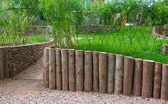 Oak Logs landscaping | Garden design with log wall