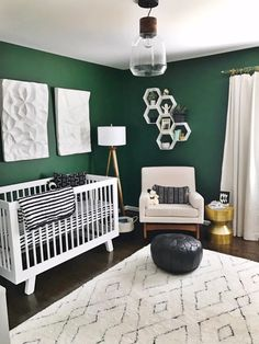 Green Nursery with Modern Black and White Accents Loving this mod nursery and the dark green walls!Loving this mod nursery and the dark green walls!