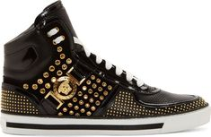 Leather high-top sneakers in black. Buffed leather trim throughout. Round toe. White lace-up closure. Perforated tongue and toe. Gold-tone hardware. Rivet accents at side panels. Micro stud accents at heel, sides, and toe wrap. Signature Medusa medallion at outer side. Tonal suede panels at sides. White rubber sole with black Greek key detail. Tonal stitching.