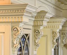 Crown molding with cornices in a kitchen above cabinets
