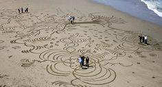 Hire a sand designer to create a team building experience on the beach.