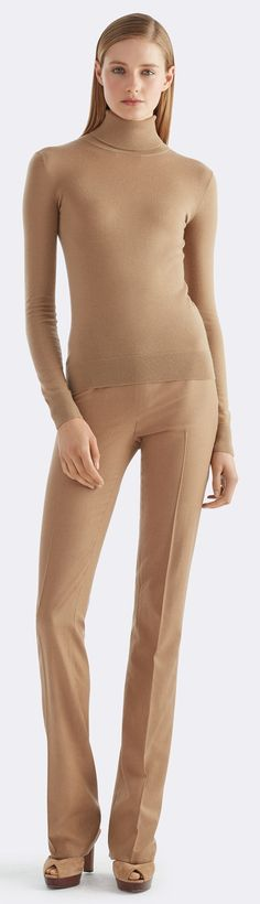 The perfect camel turtleneck: Knit from Italian cashmere that's as airy as it is sumptuous, this camel-hued turtleneck is a sleek style. Its slim fit makes it an ideal complement to tailored trousers or polished pencil skirts.