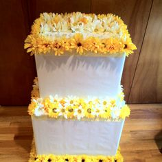 "DIY-wedding shower ""wishing well"" cake- two boxes, white wrapping paper, ribbon, and fake flowers. Wrap the boxes like presents, glue together and make top removable. Use a hot glue gun to attach ribbon and flowers. Super easy!"